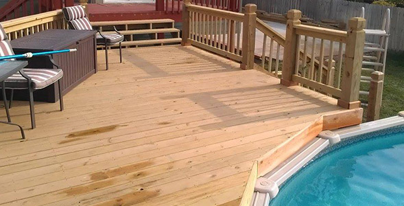 Custom built wood deck metal bars instead of spindles on deck railing