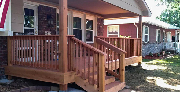 Cedar front porch deck on red brick home
