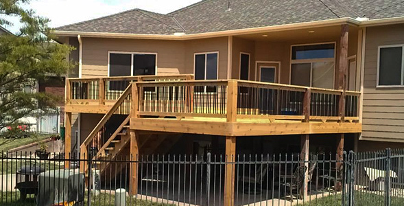 Custom built large wood deck with metal railing