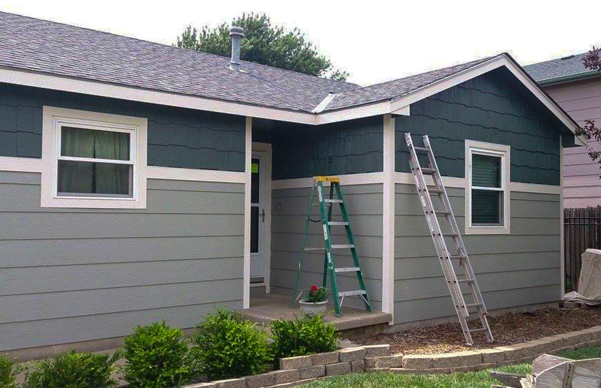this is an image of a modest two-tone paint job on a single level home.