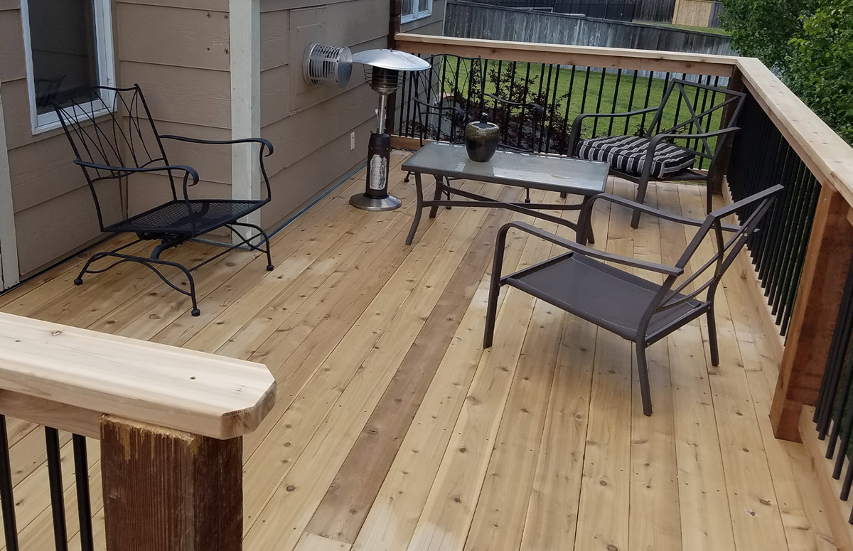 Upper level wood deck in need of some outdoor pillows and lighting