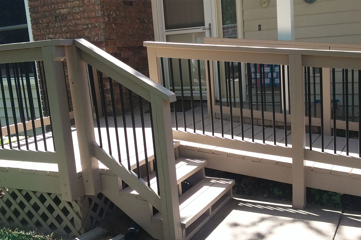 Cute front porch/deck with wheelchair ramp