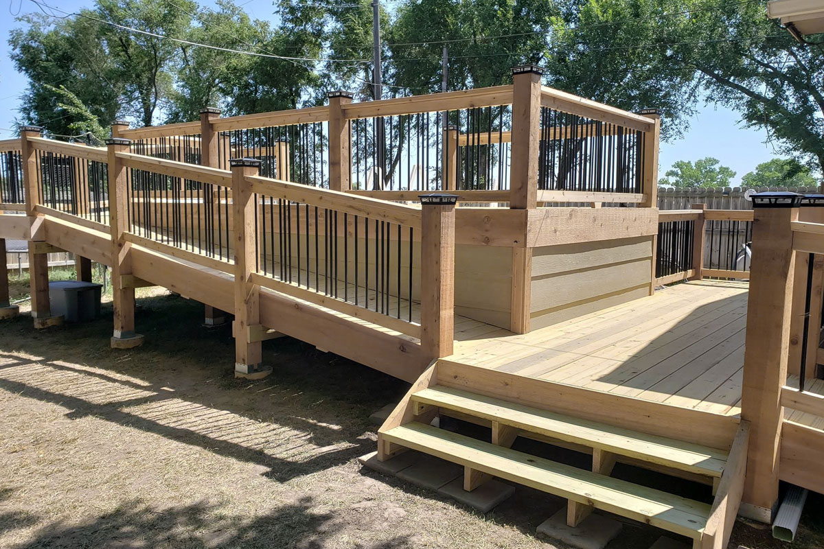 Deck Builders Wichita KS - Beautiful elevated deck with ramp - Wheel Chair Accessible for Special Needs and Disability Needs